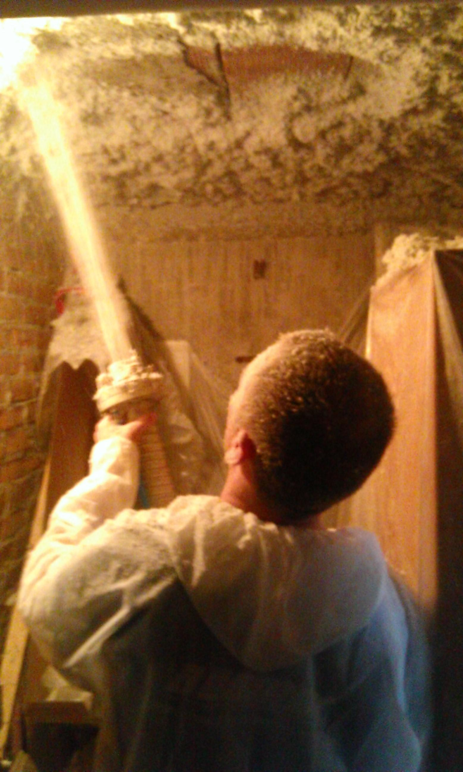 Spraying granules of wool on the basement ceiling